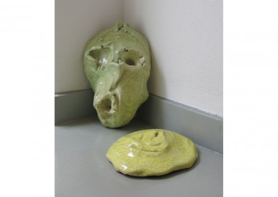 <strong>Two Masks</strong> 2010<br>Glazed ceramics 25x25x8cm each